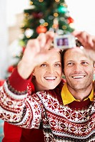 Couple Taking Picture with Digital Camera