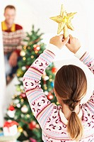 Daughter Decorating Christmas Tree