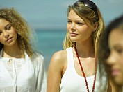 Close-up of three young women on the beach