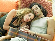 Portrait of a young couple lying down