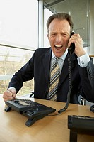 Businessman shouting on the telephone