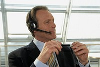 Close-up of a businessman wearing headset