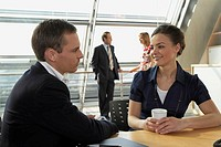 Businessman and a businesswoman talking to each other