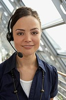Businesswoman wearing headset and smiling