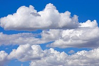 Cumulus Clouds Floating in Clear Blue Sky in Fall