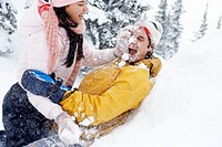 Couple Playing in Snow Outdoors