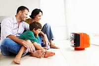 Family Watching Portable Television