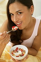 A woman eating cereal
