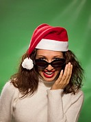 Woman wearing Christmas hat and sunglasses