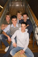Portrait of a group of young people sitting on steps and smiling