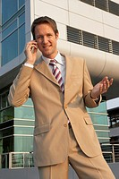 Businessman talking on a mobile phone and smiling