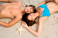 Couple lying on beach
