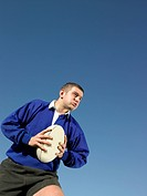 Rugby player holding rugby ball