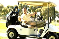 Man relaxing in golf cart