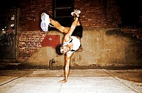 Hispanic man doing handstand