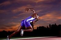 Male athlete running on track