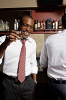 Businessman having shots in bar