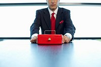 Businessman with a cash box