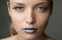 Young woman with silver colored lips part of, close-up