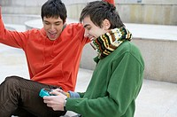 Two young men playing computer game