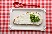 Bread with cream cheese and heart-shaped chives
