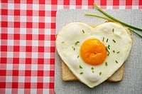 Heart-shaped fried egg on toast