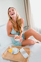 Happy woman with breakfast
