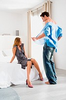 Man undressing for woman