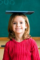 Girl balancing book on head (thumbnail)
