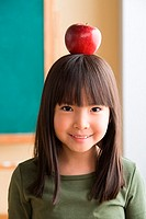 Girl balancing apple on head (thumbnail)