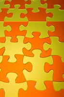 Orange and yellow jigsaw pieces