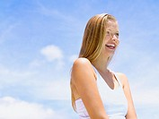 Woman outdoors with blue sky