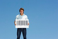 Man outdoors holding proof of purchase sign