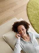 Woman on a cellular phone smiling