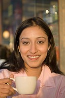 Portrait of a businesswoman holding a coffee cup and smiling