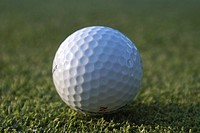 Golf ball on organic golf course, Canada, Manitoba, Riding Mountain National Park