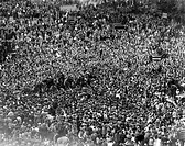 Jubilant London crowds mob the Prime Minister, Winston Churchill on Victory in Europe Day at the end of the Second World War  Churchill is just visibl...
