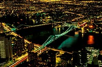 Aerial view of bridge in city lit up at night, Brooklyn Bridge, Manhattan, USA
