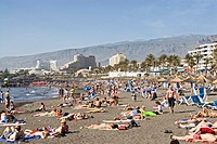 Tourists enjoying on beach, Playa De Las Americas, Tenerife, Canary Islands, Spain