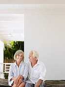 Senior couple sitting on verandah portrait