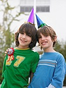Portrait of two boys 10_12 in party hats close_up