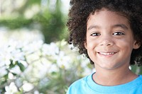 Boy 5_6 years smiling outdoors portrait close_up