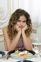 Girl 9-11 leaning on dinner table, portrait
