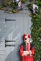 Portrait of young boy 7_9 in pirate costume by shed