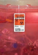 Sharps container with the biohazard symbol, used for the disposal of sharp, potentially infective medical waste