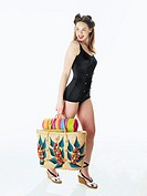 Pinup girl carrying beach bag