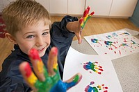 Preschool boy finger painting