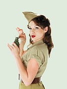 Army pinup holding grenade
