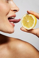 Reaching out to lick a lemon