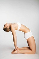 Woman stretching in camel pose